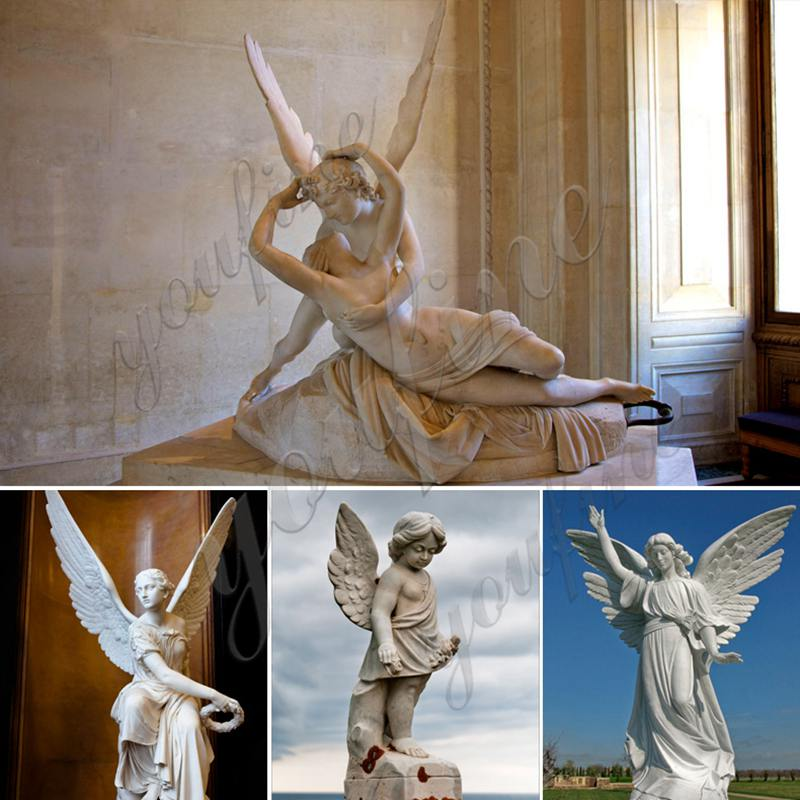 angel wings sculpture on stand